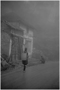 building in Sapa shrouded in low clouds