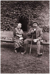 Contemporary image of two older people sat on a bench