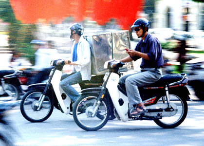 Helmet usage in Vietnam has dramatically increased, but riders aren't averse to texting whilst riding