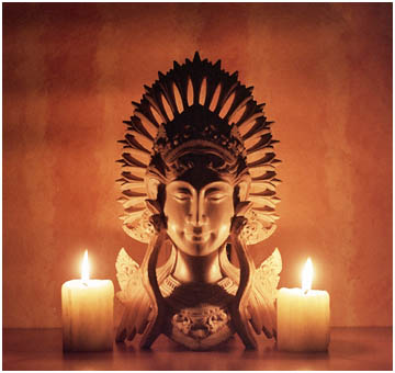 Candle lit wooden carving from Bali