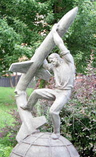 Sculpture of man snapping an ICBM