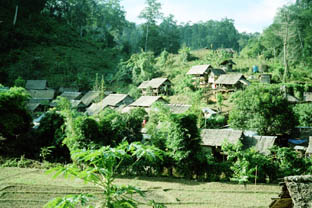 village nestling on a hillside near Mae Hong         Son
